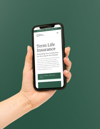 A mobile phone showing one of the service pages of the insurance website.