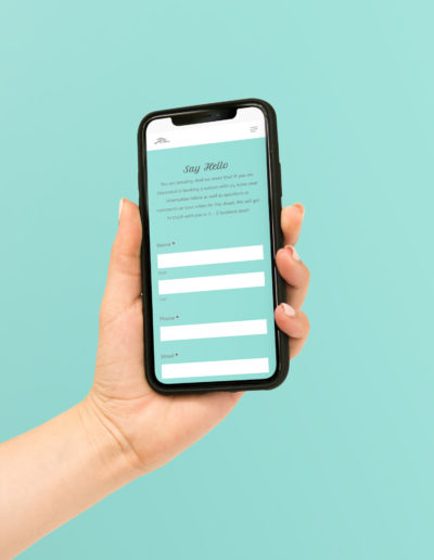 A hand holding an iPhone with a bright blue form.