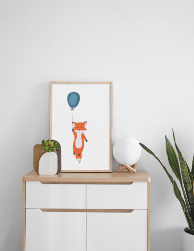 Senior living logo (a fox being held up by a balloon) on a canvas sitting on a dresser.